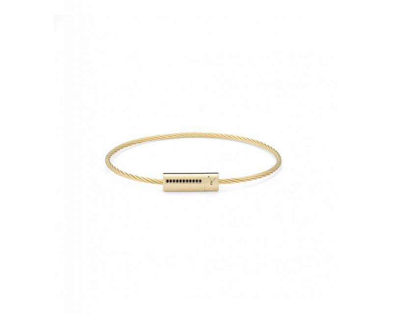 LE GRAMME Bracelet câble 9 grammes or jaune lisse poli ligne diamants noirs